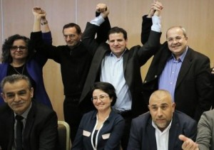 Arab-Israeli parliament members and other candidates join their hands after it was announced that a joint political slate of all the Arab parties will be running in the upcoming elections, during a news conference in Nazareth, January 23, 2015. Four political parties that mostly represent Israel's Arab minority have decided to run together in elections on March 17, creating a potential counter-weight to Prime Minister Benjamin Netanyahu and his right-wing allies. Opinion polls suggest the united Arab list could secure 11 seats in the 120-seat parliament, around the same level as they hold individually but with their political influence increased. REUTERS/Ammar Awad (ISRAEL - Tags: POLITICS ELECTIONS) - RTR4MO03