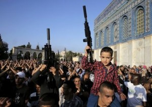 Palestinian children hold toy guns during a protest on the compound known to Muslims as al-Haram al-Sharif and to Jews as Temple Mount in Jerusalem's Old City, against Israel's military offensive in Gaza July 28, 2014. Israel eased its assaults in the Gaza Strip and Palestinian rocket fire from the enclave declined sharply on Monday, the military said, with both the United States and United Nations calling for a durable ceasefire. REUTERS/Ammar Awad (JERUSALEM - Tags: POLITICS CIVIL UNREST CONFLICT RELIGION) - RTR40CJ7