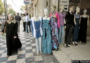 A Palestinian woman walks next to mannequins outside shops in Gaza City July 28, 2010. The Islamist rulers of the Gaza Strip have ordered lingerie shops to display more modesty. A week after banning women from smoking water pipes in public places, the Hamas-run police force has told stores selling women's underwear to remove scantily-clad mannequins and any posters of racy undergarments. REUTERS/Ismail Zaydah (GAZA - Tags: POLITICS SOCIETY RELIGION BUSINESS)